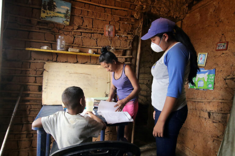 A teacher visits student at home after the closing of schools during the nationwide quarantine due to coronavirus disease (COVID-19) outbreak in El Pao